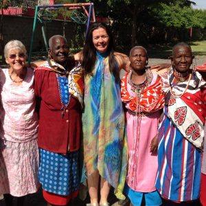 Corinne with her daughter, Michelle, with some of the Maasai grandmothers who have children at the school